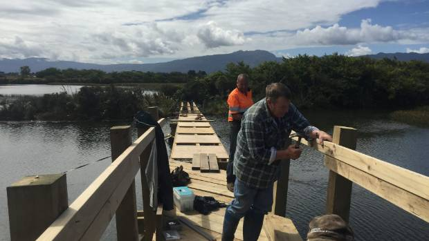Volunteers building the Kawatiri River Trail.