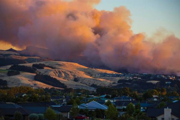 Smoke roars out above the Port Hills.