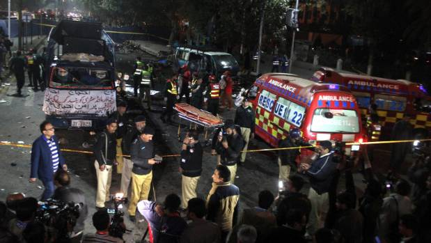 Police and rescue workers work at the scene of a blast in Lahore, Pakistan.