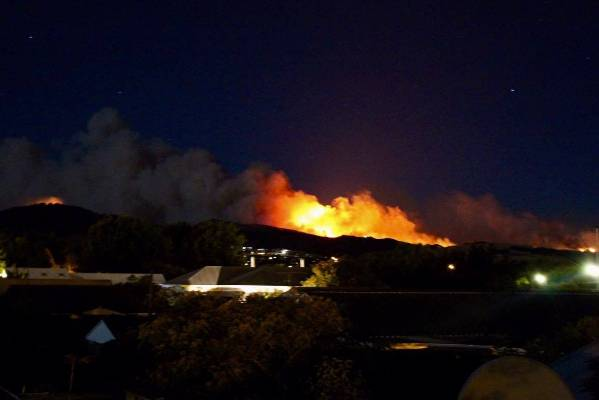 The view of the fire on the Port Hills from Halswell as night falls.