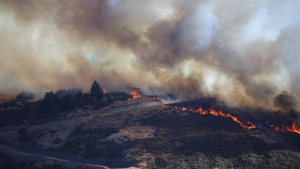 A line of flames burns across the Port Hills. Source: Stuff.co.nz.