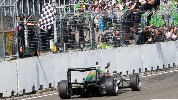 New Zealand Grand Prix winner Jehan Daravula takes the chequered flag at Manfeild on Sunday.