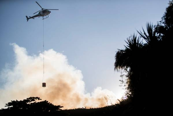 Helicopters with monsoon buckets were used to try and control the blaze.