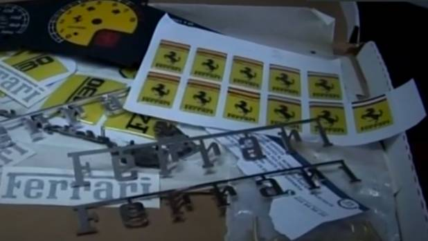 Some of the Ferrari stickers seized by police when they raided a shop making counterfeit supercars in Spain.