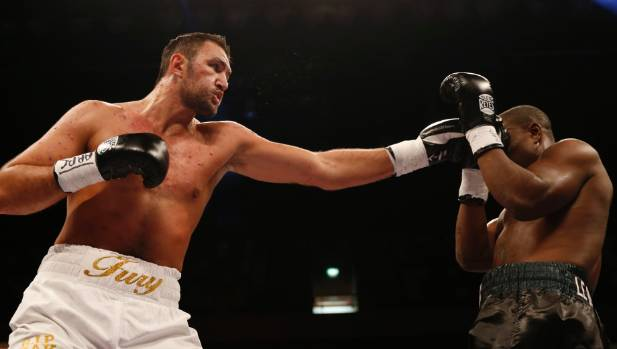 Hughie Fury uses his long reach in his last fight against Fred Kassi last April.