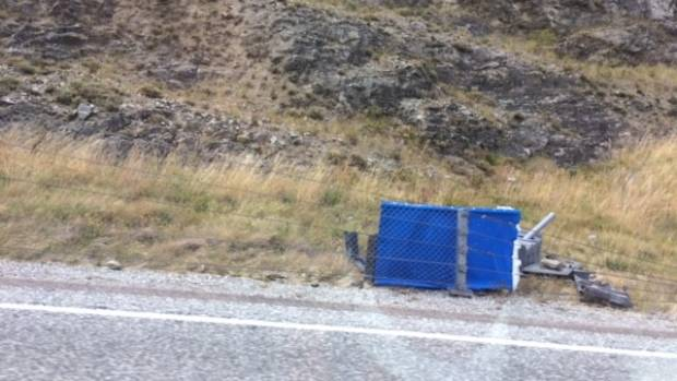 A portaloo which came off the back of a truck and damaged a car near Cromwell.