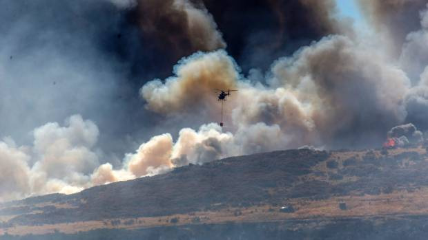 Christchurch declares emergency as bushfire destroys homes; one dead