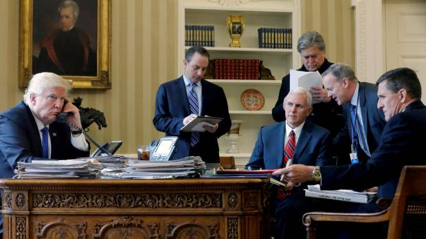 Michael Flynn (far right) listens as US President Donald Trump speaks by phone with Russia's President Vladimir Putin in ...