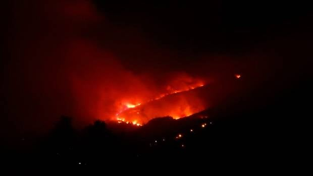 Flames glow as fire spreads through the Port Hills.