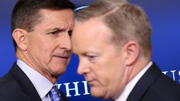 National security adviser General Michael Flynn (L) arrives to deliver a statement next to Press Secretary Sean Spicer ...