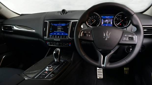 Interior quality and materials exquisite in some places; family connection to Fiat Chrysler is too obvious in others.