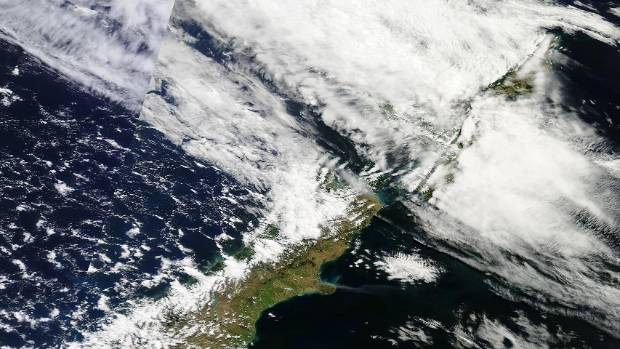 A satellite image from Nasa shows smoke from the fires ravaging Christchurch's Port Hills.