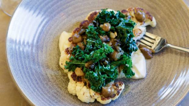 Cauliflower steak with kale, brown butter and fried capers.
