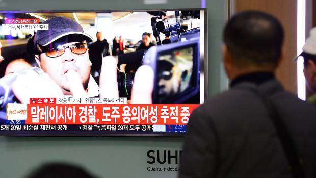People watch a TV screen broadcasting a news report on the death of Kim Jong Nam in Seoul.