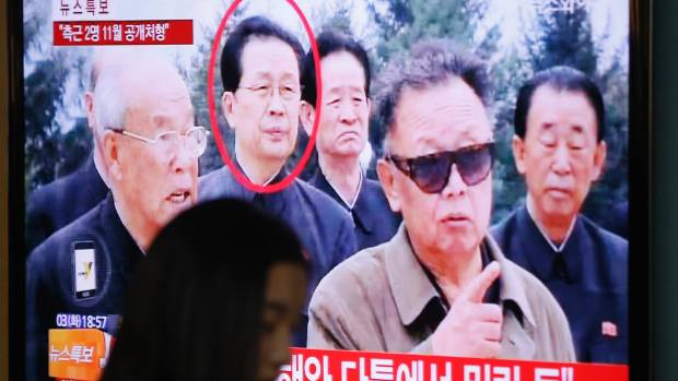 A TV shows a report on Jang Song Thaek, the uncle of leader Kim Jong Un, who was executed for treason in 2011.