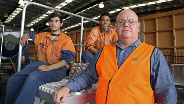 Ullrich Aluminium national sales manager Kevin van der Merwe (front) says imports that are cheaper but not up to New ...