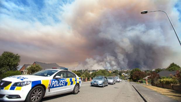 Police stop residents from entering Westmorland as the fire front heads towards the suburb.
