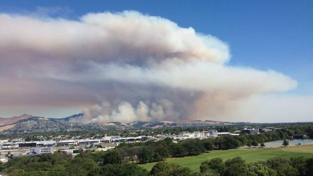 Growing smoke cloud over Christchurch's Port Hills.
