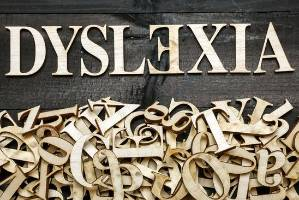 ''Dyslexia'' word with wooden letters on dark background - dyslexic - for Stuff Nation assignment
