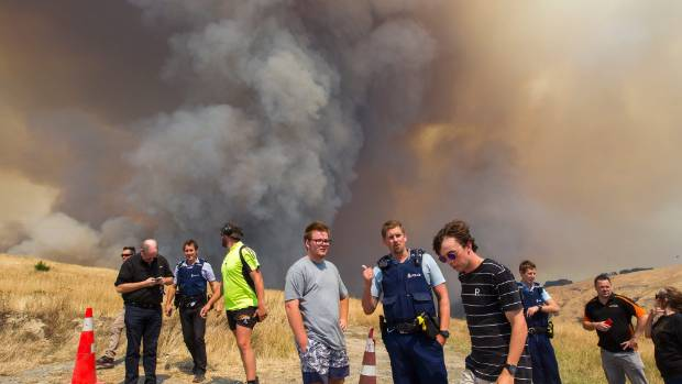 Smoke blanketing the hillside suburbs is likely to be at worse levels than Shanghai. Onlookers above Westmorland are ...
