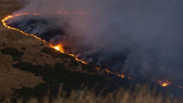 A line of fire burns across the Port Hills on Wednesday evening.