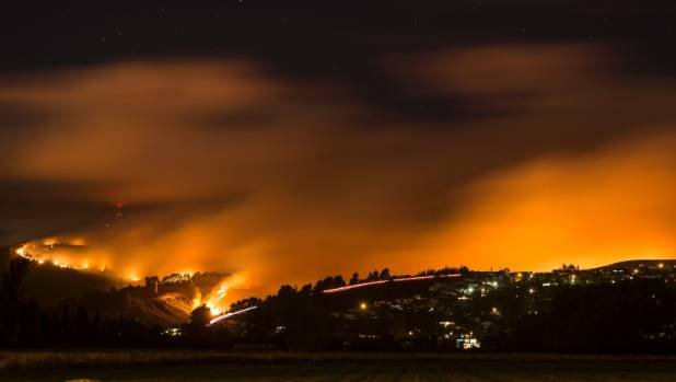 Fire lights up the Port Hills at midnight Wednesday.