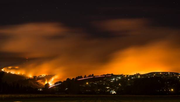 Way past the witching hour, fire blazes on at Port Hills.