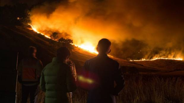 Christchurch residents look on as the Port Hills fire burns.