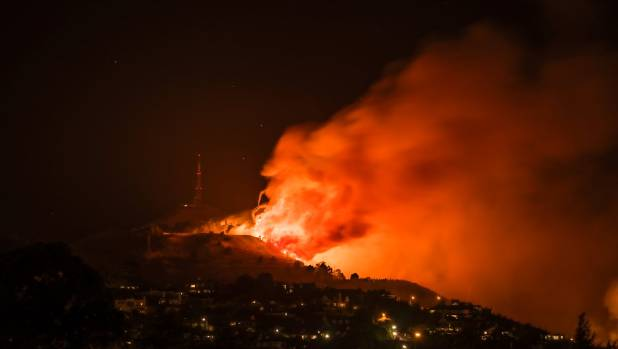 The Port Hills blaze burns by Sugerloaf.