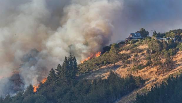 Flames head toward houses on Worsleys Spur, Christchurch.