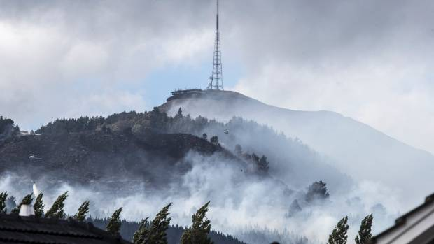 Smoke sweeps across the Port Hills on Thursday morning.