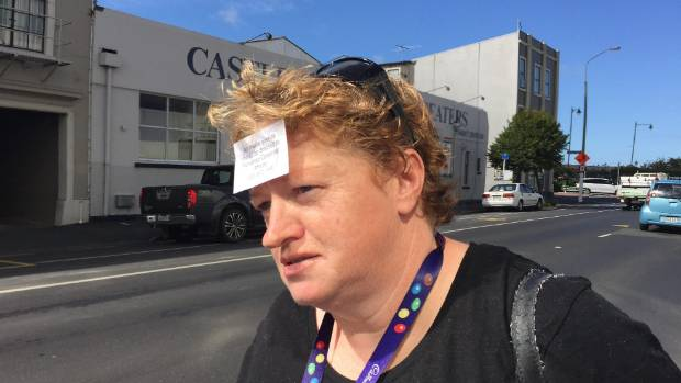 A worker at Dunedin's Cadbury factory wears a media contact card on her forehead.