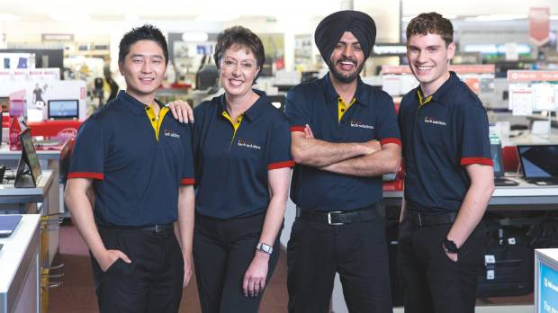Davinder, second from the right, makes sure customers have a new understanding of their devices as part of the Tech ...