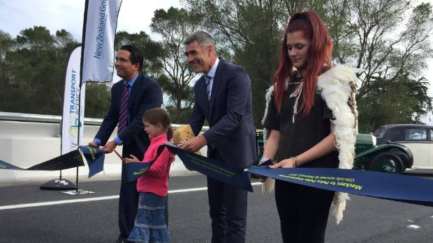 Snipping the ribbon on the first section of the Kapiti expressway is Transport Minister Simon Bridges, Te Ati Awa iwi ...