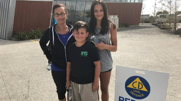 Sharon Tite, Levi Beynon, 11 ,and  Destiny Beynon, 15,  after they evacuated.