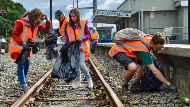 Hutt South Green Party candidate Susanne Ruthven (left) and Rimutaka candidate Stefan Grand-Meyer (right) help clean up ...