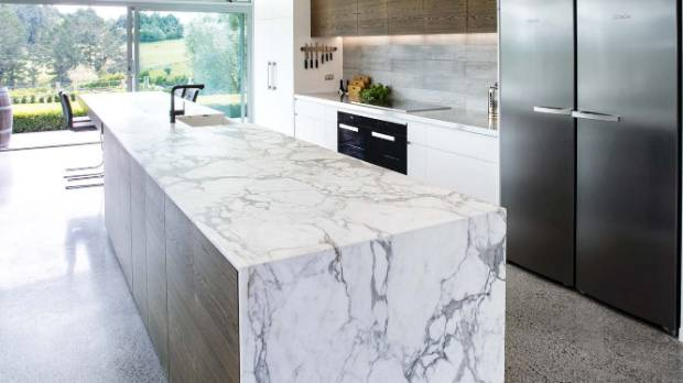 """It takes an eye for detail,"" says Leonie about the perfectly matched marble veining over the waterfall end."