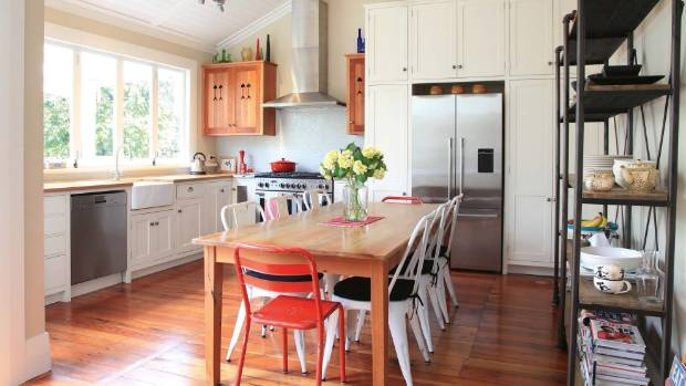 Childhood memories influenced the traditional design of this villa kitchen; the benchtops are solid white oak.
