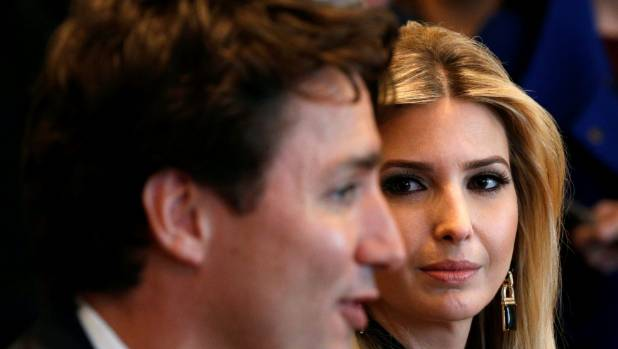 Ivanka Trump looks at Canadian Prime Minister Justin Trudeau during a US. President Donald Trump's roundtable discussion.