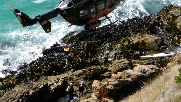 The Otago Rescue Helicopter airlifts an injured member of a sea kayak party at Nugget Point.