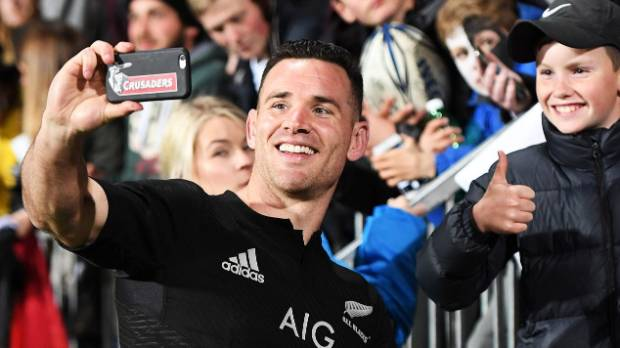Ryan Crotty, pictured celebrating with a fan after the All Blacks played the Springboks in Christchurch last year, ...