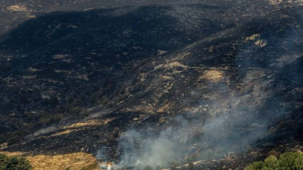 Large swathes of the Port Hills have been burned to a cinder.