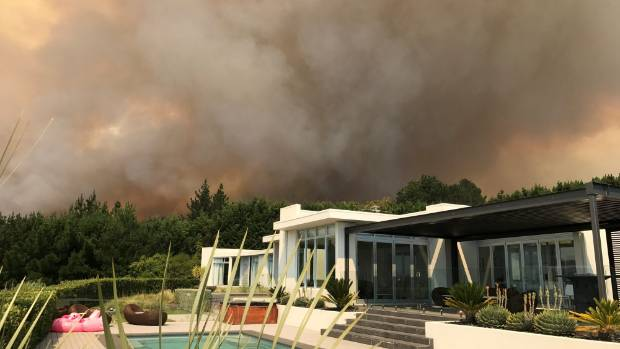 Pool saved house: Miranda Newbury took this photo minutes before evacuating the home she shares with husband Craig and ...