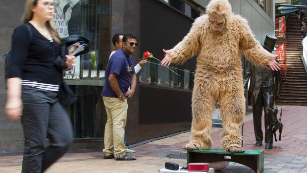 The gorilla man does his thing on Lambton Quay, near the Plimmer steps.
