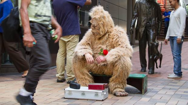 "A Wellington retail group says the ""gorilla man"" in the central city uses different tactics to get money, such as a ..."