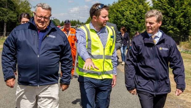 Civil Defence Minister Gerry Brownlee, left, Mayor of Selwyn District Sam Broughton and Prime Minister Bill English ...