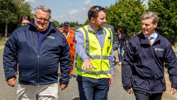 Selwyn District Mayor Sam Broughton, centre, pictured with Civil Defence Minister Gerry Brownlee, left, and Prime ...