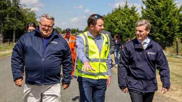 Civil Defence Minister Gerry Brownlee (left), pictured with Selwyn District Mayor Sam Broughton and Prime Minister Bill ...