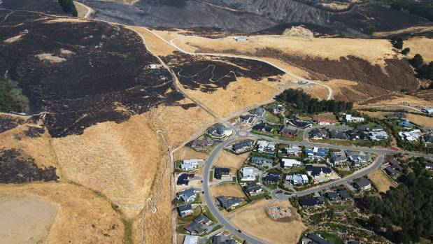 The two fires combined and more than doubled in size over night on Wednesday, threatening homes in the Port Hills.