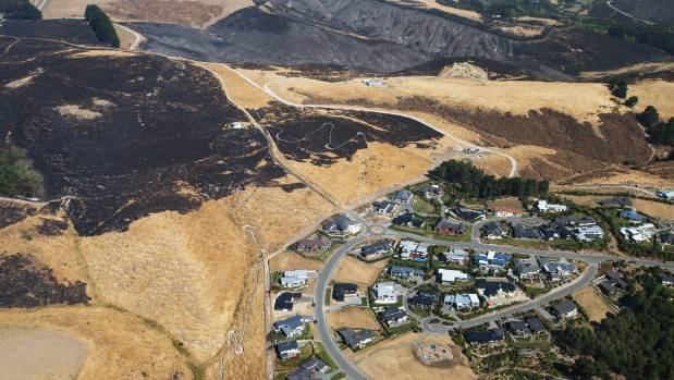 Top of Kennedys Bush Road shows how close the fires came to residences.